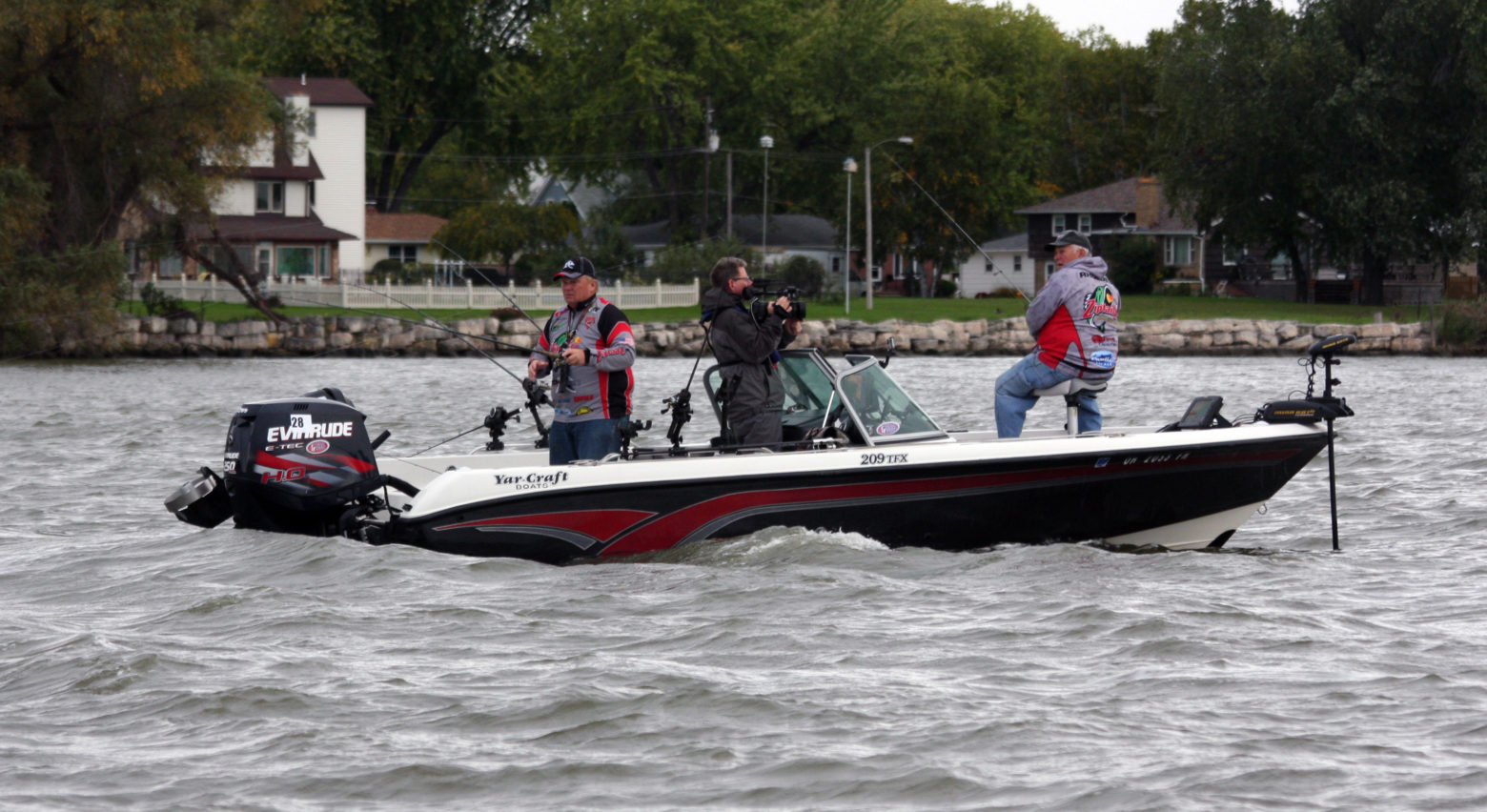 With a TV camera person aboard to record the action for national airing, Gaines and Rhodes tested the waters of the Fox River.